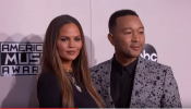 Chrissy Teigen silenced her critic with her humorous tweets after her wardrobe malfunction at AMA.
