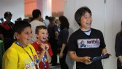 Robbie, 10, have fun playing Mario Maker (working title) for the first time with Shigeru Miyamoto, the creator of Super Mario Bros