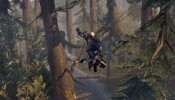 Connor leaps through wilderness in Assassin's Creed III