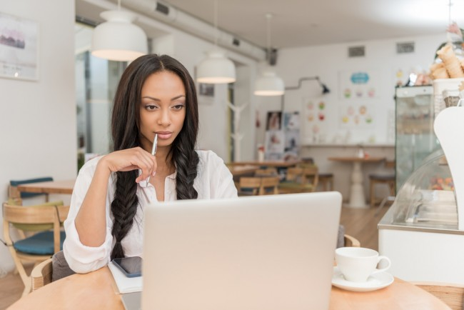 Businesswoman with laptop at cafe